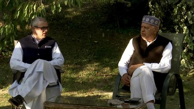 National Conference (NC) president Farooq Abdullah interacts with son and National Conference's vice president Omar Abdullah during an all-party meeting in Srinagar.(ANI/ File photo)