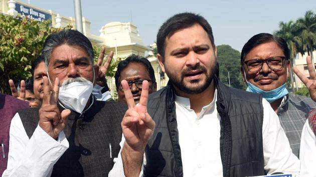 Grand Alliance candidate and RJD MLA Awadh Bihari Chaudhary and RJD leader Tejashwi Yadav address media outside the Bihar assembly, in Patna on November 24.(ANI)