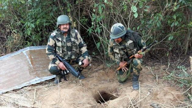BSF personnel carry out an extensive search near Regal Post along the International Border, a day after an underground tunnel was detected by the forces, in Samba district on November 23.(PTI)