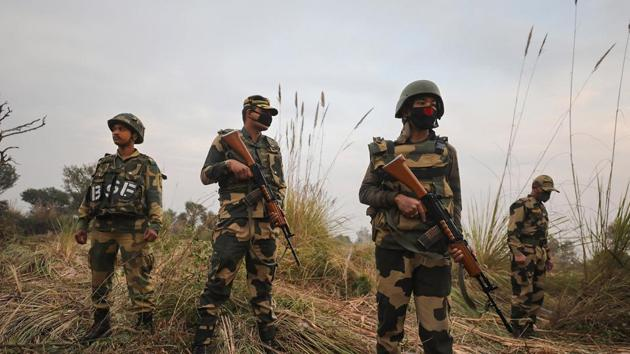 Jammu: Security personel stand gurad beside an underground tunnel near the international border in Samba sector, suspected to have been used by terrorists killed in a recent encounter in Nagrota, in Jammu district(PTI)