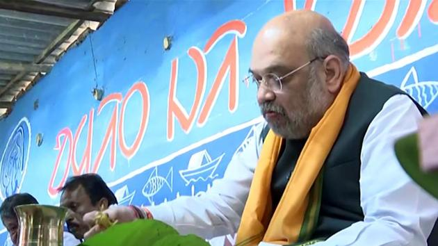 Union Home Minister and BJP leader Amit Shah having food at the house of a tribal family at Chaturthi village, in Bankura, West Bengal.(ANI)