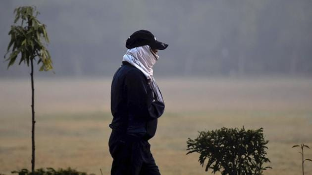 A man wearing head warmers jogs on a cold morning in New Delhi on November 24. The Safdarjung Observatory in the capital recorded a minimum of 6.3 degrees Celsius, five notches below normal on November 23. The maximum here settled at 26.2 degrees Celsius, normal for this time of the year, HT reported. (Kamal Singh / PTI)