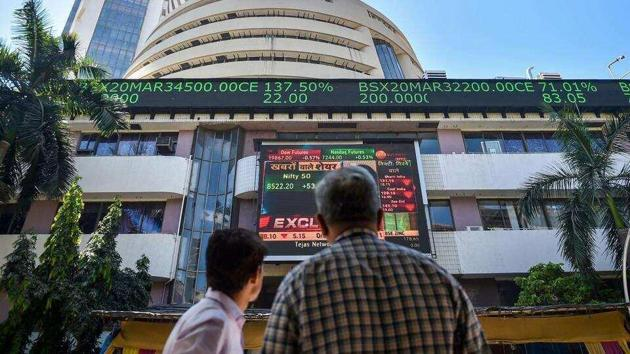 People watch the Sensex on a screen outside Bombay Stock Exchange (BSE) in Mumbai.(PTI File Photo)