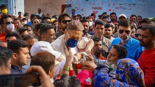 AIMIM President and MP Asaduddin Owaisi participates in a door-to-door GHMC election campaign for Jambagh candidate Jadala Ravindra at Jambagh division in Hyderabad.(PTI)