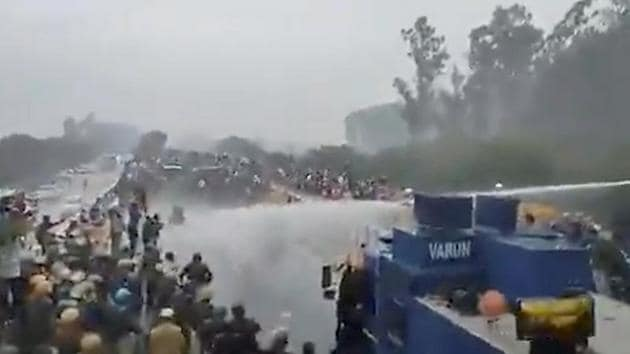 Water cannons being used on protesting farmers, in Kurukshetra on Wednesday.(PTI Photo)