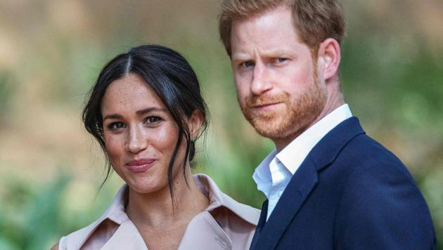 Britain's Prince Harry, Duke of Sussex(R) and Meghan, the Duchess of Sussex(L)(AFP file photo)