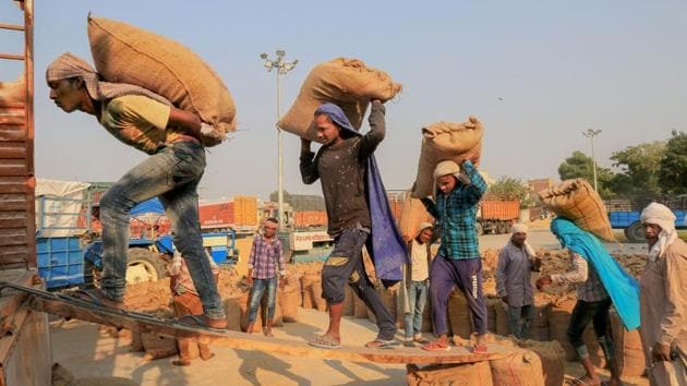 Labourers load sacks of newly harvested paddy crop on a truck.(Representative Photo/PTI)