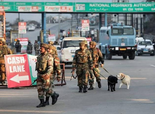 Security officials after the encounter in which four suspected Jaish-e-mohammad terrorists were killed by security forces after they were found hiding in a truck on Srinagar National Highway, near Nagrota, Jammu and Kashmir.(HT photo)