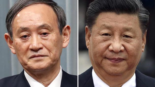 Japan's Prime Minister Yoshihide Suga (left) and Chinese President Xi Jinping(AP photo)
