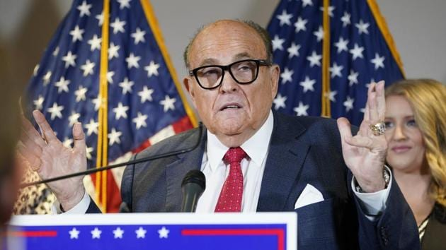 Giuliani doubled down on his conspiracy claims in an off-the-rails Thursday press conference alongside Trump lawyer Jenna Ellis and Sidney Powell, whom the campaign disowned on Sunday.(AP Photo)