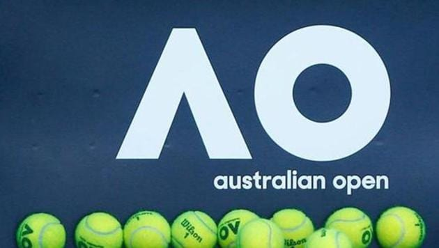 Tennis balls are pictured in front of the Australian Open logo before the tennis tournament.(REUTERS)