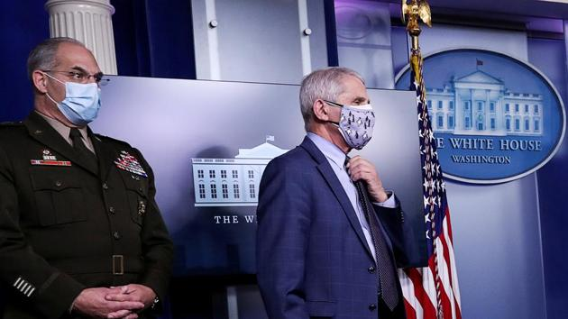 US Army Gen. Gustave Perna, who co-leads the Trump administration effort and Dr. Anthony Fauci, director of the National Institute of Allergy and Infectious Diseases, listen during a briefing by the White House coronavirus task force.(Reuters/ File photo)