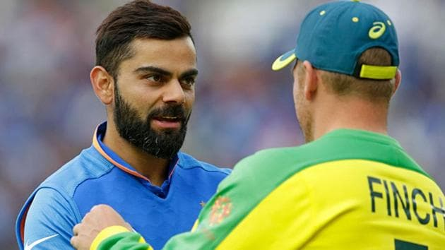 Virat Kohli and Aaron Finch(Getty Images)