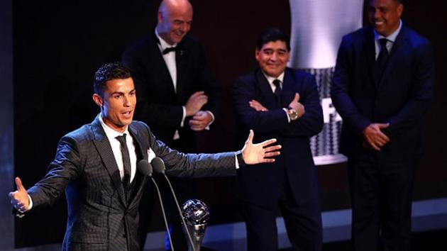 Cristiano Ronaldo wins The best Fifa men's player as Diego Maradona, Gianni Infantino and Ronaldo look on.(Getty Images)
