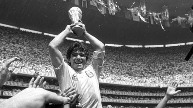 Argentine star Diego Maradona holds up the World Cup trophy as he is carried off the field after Argentina defeated West Germany 3-2 to win the World Cup soccer championship in Mexico City June 29, 1986.(REUTERS)