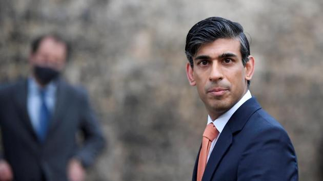 Britain's Chancellor of the Exchequer Rishi Sunak looks on as he leaves following an outside broadcast interview.(REUTERS)