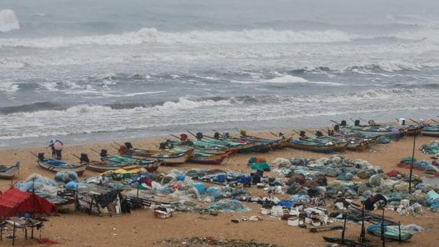 Boats are seen parked on deserted Marina beach during rains before Cyclone Nivar's landfall, in Chennai.(REUTERS)