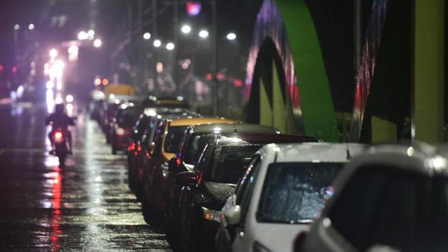 Residents park their vehicles on a flyover to prevent damage from Cyclone Nivar in Chennai on November 25. To further prevent any casualty from the cyclone, all major arterial roads have been closed in Chennai in addition to the suspension of domestic and international flights. (R. Senthil Kumar / PTI)