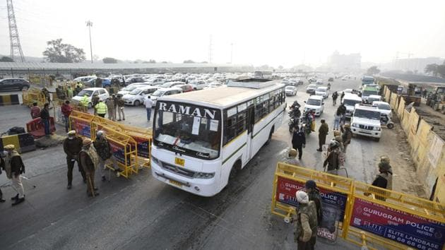 Police deployment and barricading in place at Delhi-Gurugram border in light of the farmers' march, in Gurugram on November 26. Haryana authorities have also imposed prohibitory orders under Section 144 in several parts of the state to prevent assembly of protesters. (Parveen Kumar / HT Photo)