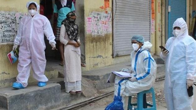 Medical workers in PPE overalls during a screening exercise in Sirhaul village during a nationwide lockdown due to coronavirus pandemic, at Sirhaul village.(Yogendra Kumar/HT PHOTO)