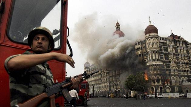 """Mumbai: **FILE** Smoke is seen billowing out of the ground and first floor of the Taj Hotel in south Mumbai during security personnel's """"Operation Cyclone"""" following the 26/11 terror attacks in 2008.(PTI)"""