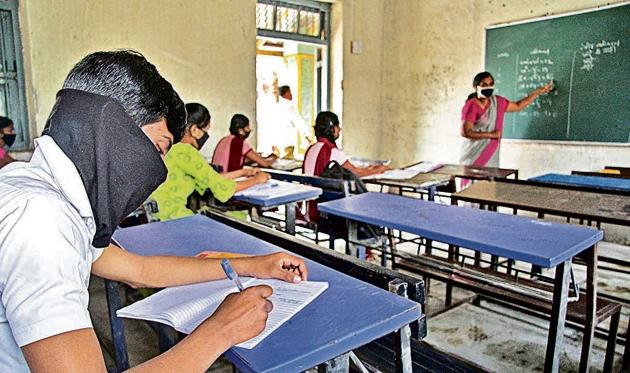 Schools in the rural parts of Pune district reopened for classes 9 to 12 on November 23 following all safety precautions. However, attendance has still been very low.(Ravindra Joshi/HT PHOTO)