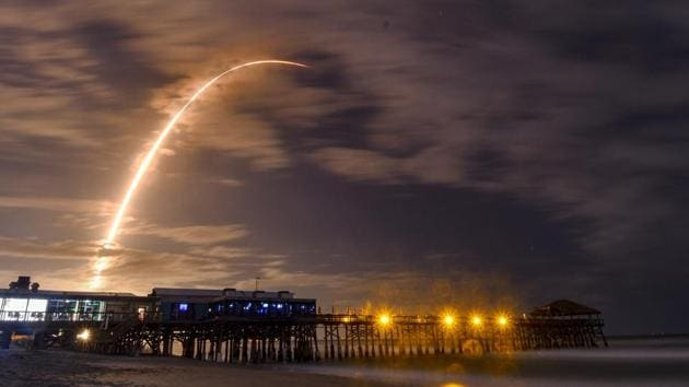 In this time exposure taken from Westgate Cocoa Beach Pier in Cocoa Beach, Fla., a SpaceX Falcon 9 rocket lifts off from Pad 40 at Cape Canaveral Air Force Station, Fla., on Tuesday.(AP Photo)