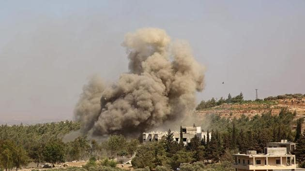 Smoke billows following a reported Russian airstrike on the western outskirts of the mostly rebel-held Syrian province of Idlib.(AFP)