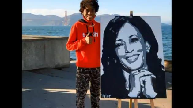 The image shows Tyler Gordon, 14, with Kamala Harris' portrait.(Twitter/@Official_tylerg)