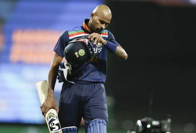 India's Hardik Pandya walks from th field after he was dismissed for 90 runs during the one day international cricket match between India and Australia at the Sydney Cricket Ground in Sydney, Australia, Friday, Nov. 27, 2020. (AP Photo/Rick Rycroft) (AP)