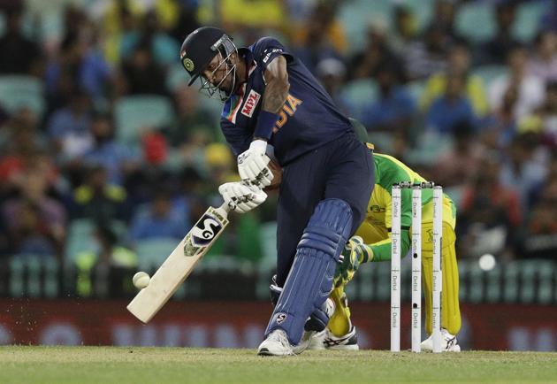 India's Hardik Pandya hits the ball for six runs during the one day international cricket match between India and Australia at the Sydney Cricket Ground in Sydney, Australia, Friday, Nov. 27, 2020. (AP Photo/Rick Rycroft) (AP)