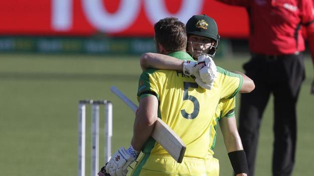 Australia's Aaron Finch is congratulated by teammate Steve Smith.(AP)