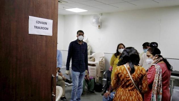 People wait during the administration of Covaxin, a government-backed experimental Covid-19 vaccine, during its human trials, at the Gujarat Medical Education & Research Society in Ahmedabad, on Thursday.(PTI Photo)