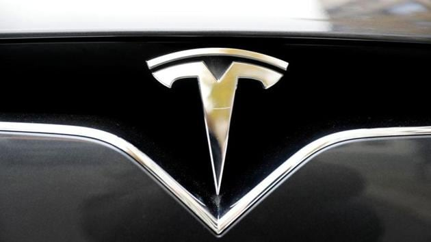 Tesla in February 2017 issued a service bulletin describing a manufacturing condition that may result in front suspension fore link failures, NHTSA said.(Reuters file photo)