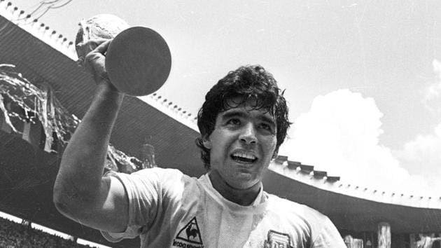 Maradona holds up the World Cup trophy as he is carried around the field in Azteca Stadium after Argentina defeated Germany 3-2 to win the World Cup in Mexico City in 1986. Maradona didn't just play football, he transformed it, elevated it to an art.(Reuters File)