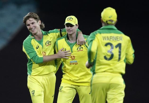 Sydney: Australia's Adam Zampa, left, and teammate Steve Smith celebrate the dismissal of India's K.L. Rahul during the one day international cricket match between India and Australia at the Sydney Cricket Ground in Sydney, Australia, Friday, Nov. 27, 2020. AP/PTI(AP27-11-2020_000152B) (AP)