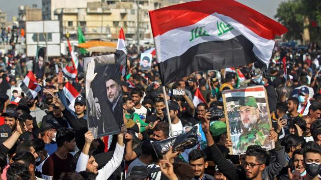 """Most of al-Sadr's followers stood unmasked in the square, chanting: """"Yes, yes for our leader,"""" in support of the firebrand cleric as Iraq remains a high-risk country for coronavirus infection.(AFP Photo)"""