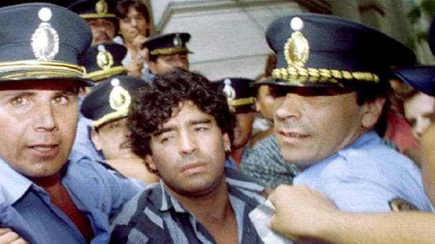"Maradona is escorted out of a courthouse amid charges that he shot and injured journalists outside his home in 1994. ""Whatever good I may do, they will still remember me for the bad I've done,"" he once said.(Reuters)"