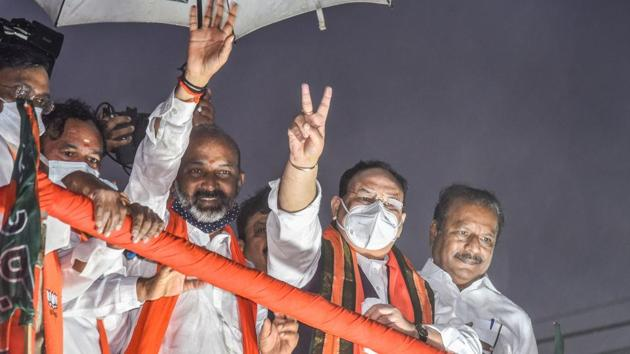 BJP president J P Nadda with minister of state for home affairs G Kishan Ready and state BJP president Bandi Sanjay during a roadshow as part of GMC election campaign, in Hyderabad on Nov 24, 2020.(PTI)