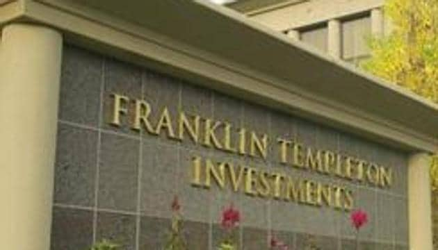 Franklin Templeton has told the markets regulator that it will comply with a high court order to seek consent from its unitholders even as it challenged the ruling(Bloomberg News)