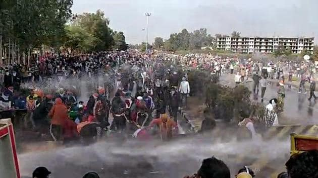 Police use water cannon and tear-gas shells in Karnal to disperse farmers from Punjab heading towards Delhi on Thursday.(ANI)