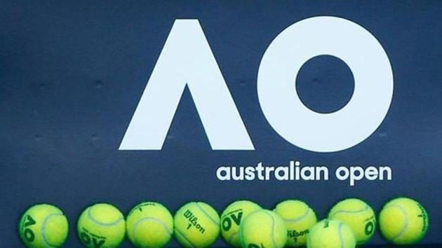 Tennis balls are pictured in front of the Australian Open logo(REUTERS)