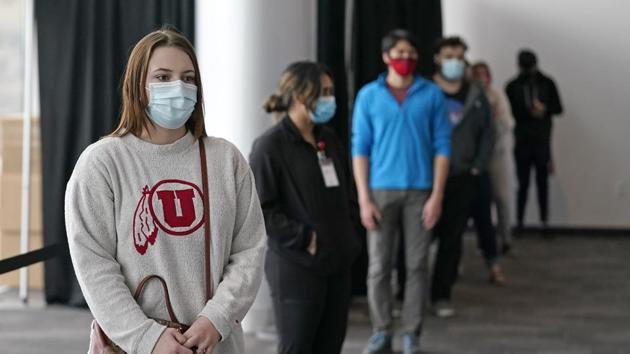 University of Utah students waits in line before taking a rapid Covid-19 test at the University of Utah student testing site in Salt Lake City.(AP)