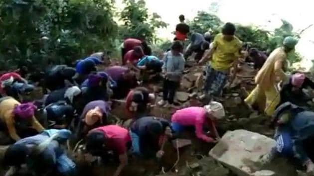 Locals in Wanching village were seen digging a small hillock in the hope that the shiny stones found there were diamonds.(HT Photo)