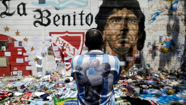 A man mourns the death of football legend Diego Maradona, outside the Diego Armando Maradona stadium in Buenos Aires, Argentina on November 27. The former Argentine Football team captain passed away in his home in Tigre near Buenos Aires on November 25 following a cardiac arrest. He was 60. (Ricardo Moraes / REUTERS)