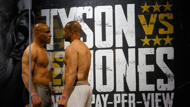Nov 27, 2020; Los Angeles, CA, USA; Mike Tyson and Roy Jones, Jr. during weigh ins for a heavyweight exhibition boxing bout for the WBC Frontline Belt in Los Angeles. Mandatory Credit: Lynn Millspaugh/Handout Photo via USA TODAY Sports(USA TODAY Sports)