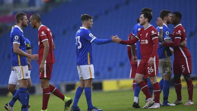 Brighton's Pascal Gross, left, greets Liverpool's Andrew Robertson at the end of the English Premier League soccer match between Brighton and Hove Albion and Liverpool at the Amex stadium in Brighton.(AP)