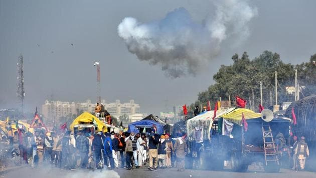 "A cloud of tear gas forms from a cannister fired by Delhi Police to disperse farmers waiting to enter the national capital in protest against farm reform laws, at Singhu Border near New Delhi on November 27. After making their way through Haryana, thousands of farmers knocked on the national capital on November 27 under the ""Delhi Chalo"" call against the agri-marketing laws enacted at the Centre in September. (Sanchit Khanna / HT Photo)"