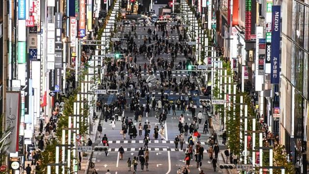 People walk on a street in Tokyo's Ginza area on November 23. (Charly Triballeau / AFP)