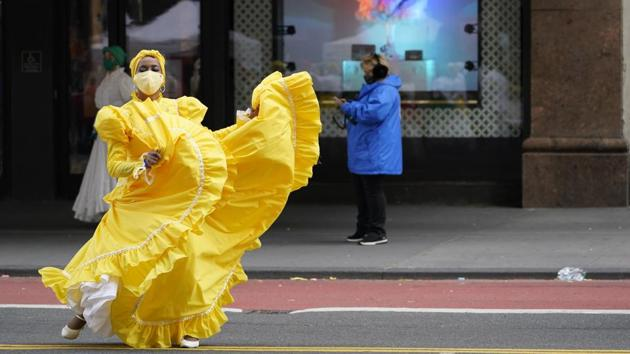 A dancer warms up along 34th Street while waiting to perform during a pre-taping of the Macy's Thanksgiving Day Parade in front of the flagship store in New York, US on November 25. Thanksgiving holiday was celebrated across the world on November 26. (Mary Altaffer / AP)